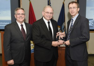 150717-N-PO203-051 ARLINGTON, Virginia (July 17, 2015) Jere Glover, center, executive director, small business technology council and Robert Smith, director, Department of the Navy SBIR/STTR programs, present Sean J. Stackley, assistant secretary of the Navy for research, development and acquisition, with an award for his support of SBIR/STTR during a brief ceremony held at the Office of Naval Research. (U.S. Navy photo by John F. Williams/Released)